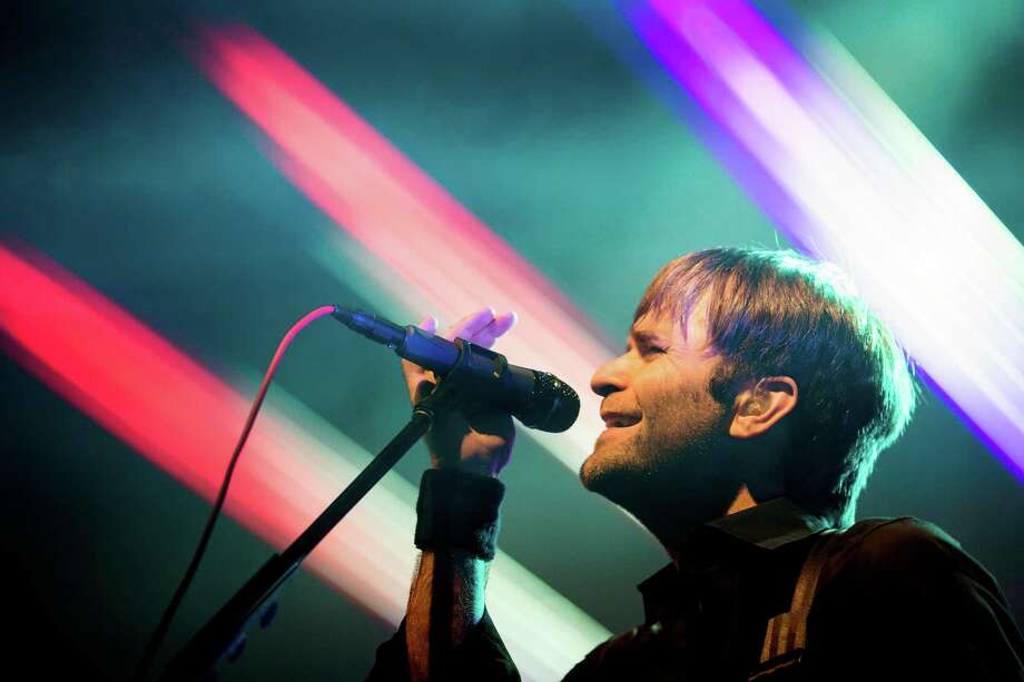 Ben Gibbard, vocalist for the electronic musical supergroup The Postal Service, performs during their first headlining tour in a decade to commemorate the tenth anniversary release of their 2003 album, Give Up!, on Thursday, July 18, 2013, at the Key Arena in Seattle. Photo: JORDAN STEAD, SEATTLEPI.COM / SEATTLEPI.COM