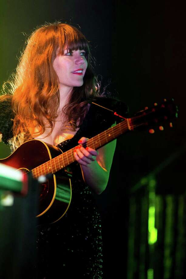 Jenny Lewis, background vocalist and keyboardist for the electronic musical supergroup The Postal Service, performs during their first headlining tour in a decade to commemorate the tenth anniversary release of their 2003 album, Give Up!, on Thursday, July 18, 2013, at the Key Arena in Seattle. Photo: JORDAN STEAD, SEATTLEPI.COM / SEATTLEPI.COM