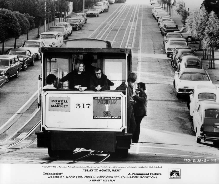 Diane Keaton and Woody Allen ride on a cable car together in a scene from the film 'Play It Again, Sam', 1972. Photo: Michael Ochs Archives, Getty Images