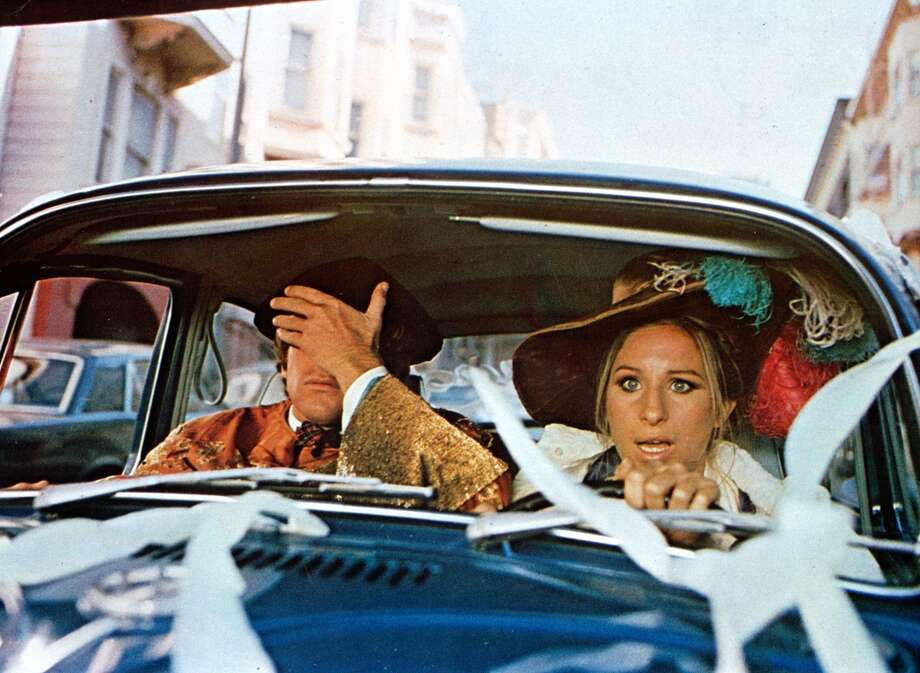 Ryan O'Neal and Barbra Streisand drive through the streets of San Francisco in 'What's Up, Doc?', 1972. Photo: Warner Brothers, Getty Images