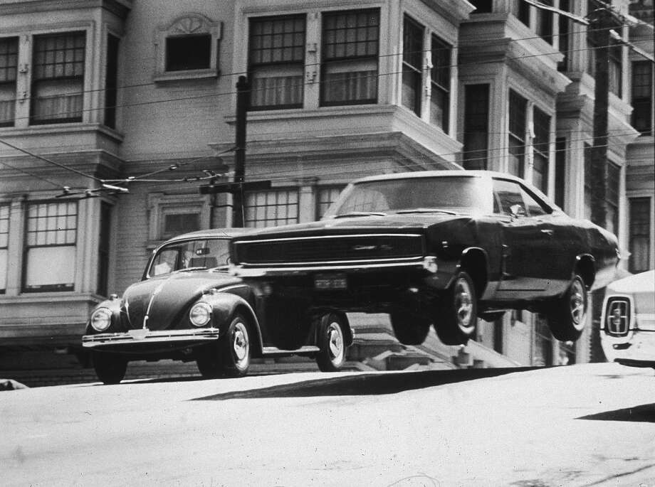 A car flies through the air while traveling down a San Francisco street in a still from the film, 'Bullitt,' directed by Peter Yates, 1968. Photo: Warner Bros., Getty Images