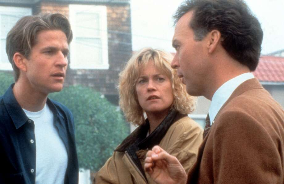 Matthew Modine, Melanie Griffith and Michael Keaton in a scene from the film 'Pacific Heights', 1990. Photo: 20th Century Fox, Getty Images