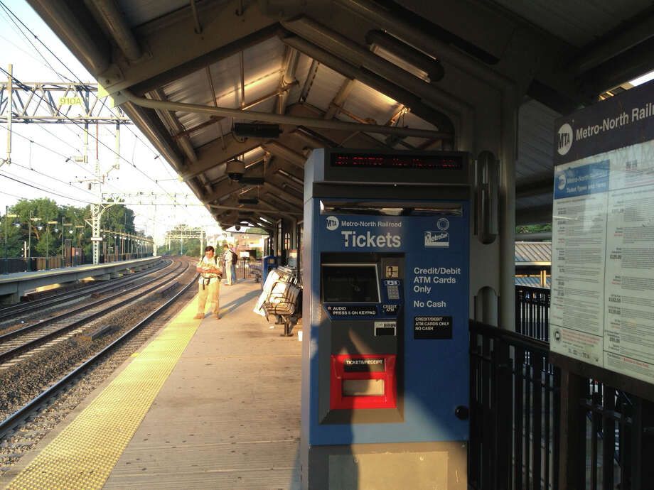 Commuters wait for a train delayed by a transformer fire July 19. Photo: Contributed / Connecticut Post Contributed