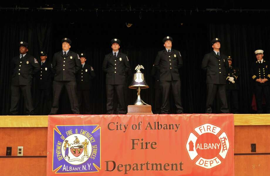 Nine firefighter recruits, eight from Albany and one from Saratoga Springs, after completing several weeks of training graduated during a ceremony at the  Albany Jewish Community Center on Thursday July 18, 2013 in Albany, N.Y.  (Michael P. Farrell/Times Union) Photo: Michael P. Farrell / 00023216A