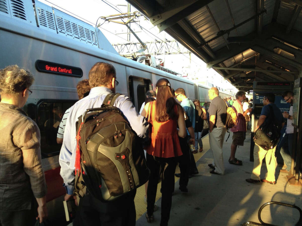 Commuters at a train station delayed by a transformer fire July 19.