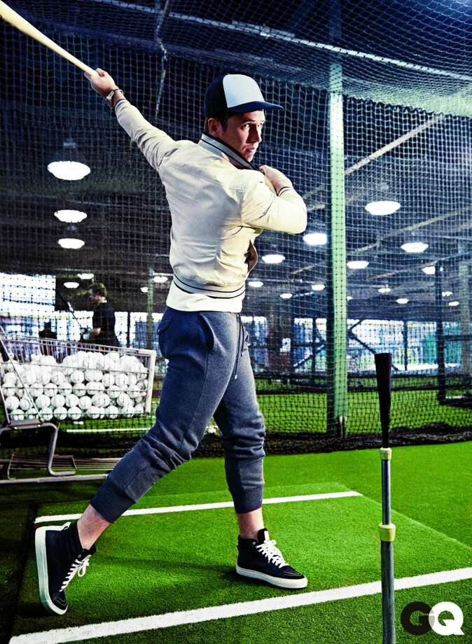 Buster Posey modeling for GQ in April 2013. He is wearing: Jacket, $150 by Banana Republic. Henley, $100 Merz b. Schwanen. Sweatpants, $325 by Michael Bastian. Sneakers, $475 by Sandro. Watch by TAG Heuer.