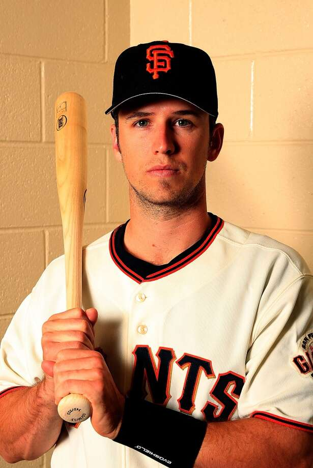 Catcher Buster Posey poses for a portrait during San Francisco Giants Photo Day on February 20, 2013.
