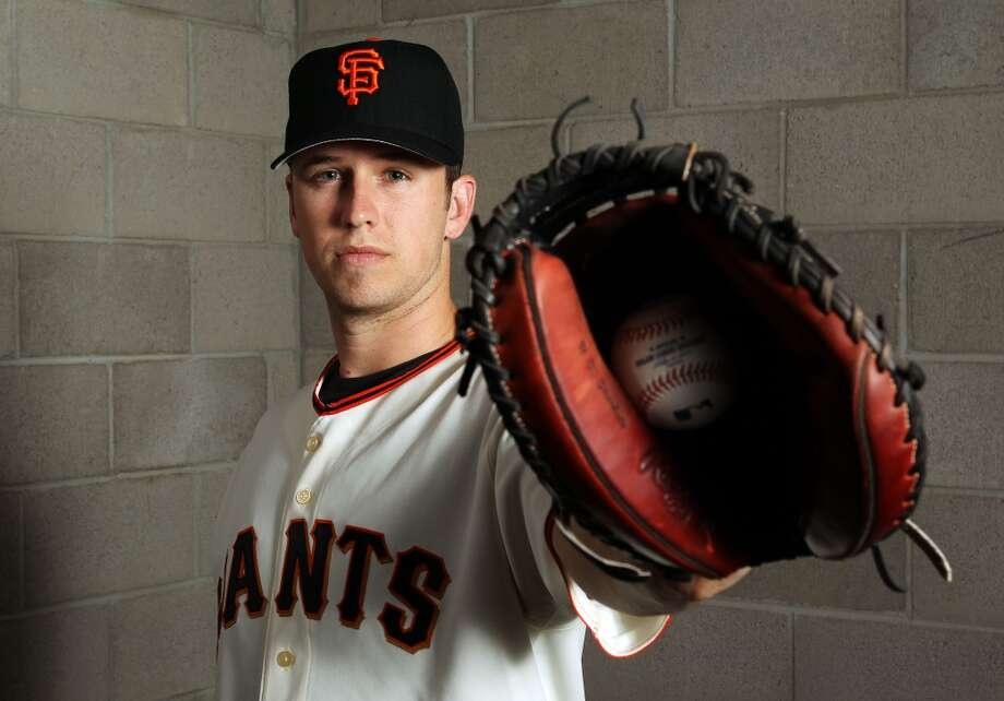 Buster Posey  poses during spring training photo day on March 1, 2012.