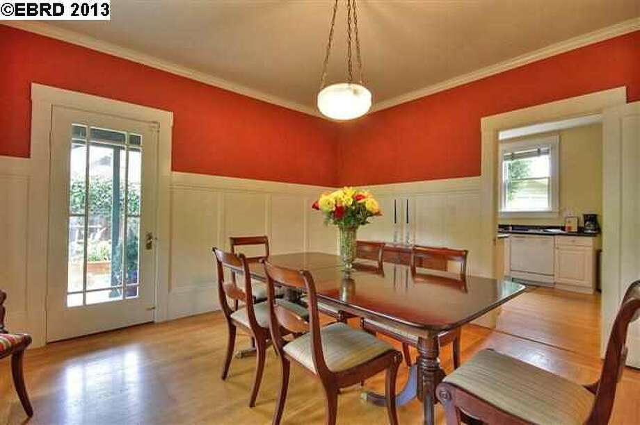 Casual dining room with a door leading to the backyard.