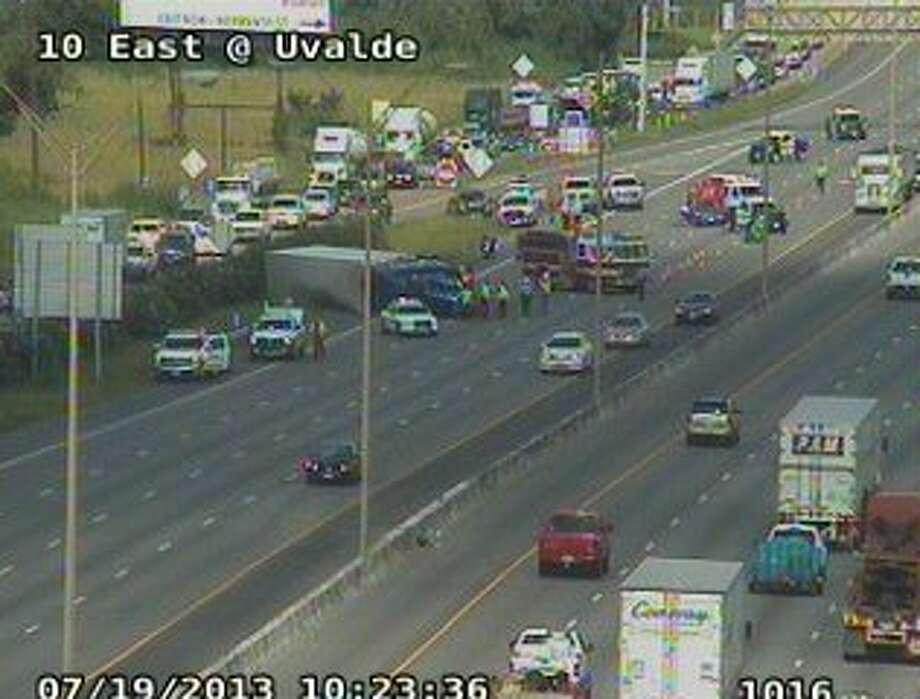 Three main lanes on I-10 east are shut down after a four-car wreck. (Houston Transtar photo)