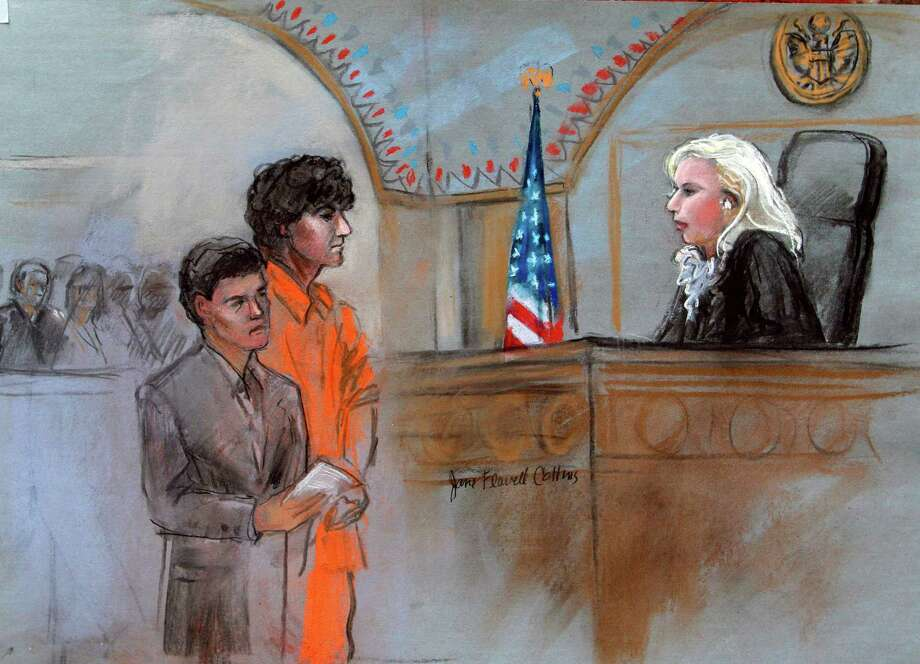 This courtroom sketch depicts Boston Marathon bombing suspect Dzhokhar Tsarnaev standing with his lawyer Miriam Conrad, left, before Magistrate Judge Marianne Bowler, right, during his arraignment in federal court Wednesday, July 10, 2013 in Boston. The 19-year-old has been charged with using a weapon of mass destruction, and could face the death penalty. (AP Photo/Jane Flavell Collins) Photo: Jane Flavell Collins / Associated Press / AP
