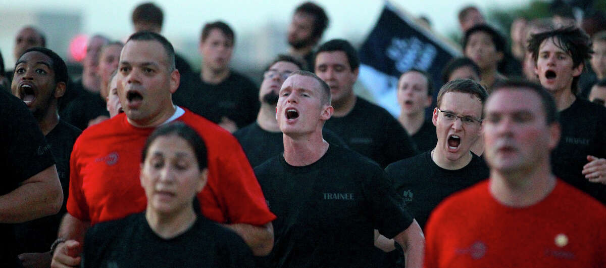 People taking part in USAA's Zero Day PT (physical training) run in formation Friday morning July 19, 2013. About 300 employees participated in the event which is intended to provide USAA employees with insight about what military recruits experience in basic training.