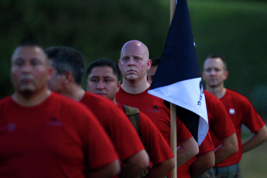 People stand at attention while taking part in USAA's Zero Day PT (physical training) Friday morning July 19, 2013. About 300 employees participated in the event which is intended to provide USAA employees with insight about what military recruits experience in basic training. Photo: JOHN DAVENPORT, SAN ANTONIO EXPRESS-NEWS / ©San Antonio Express-News/Photo may be sold to the public