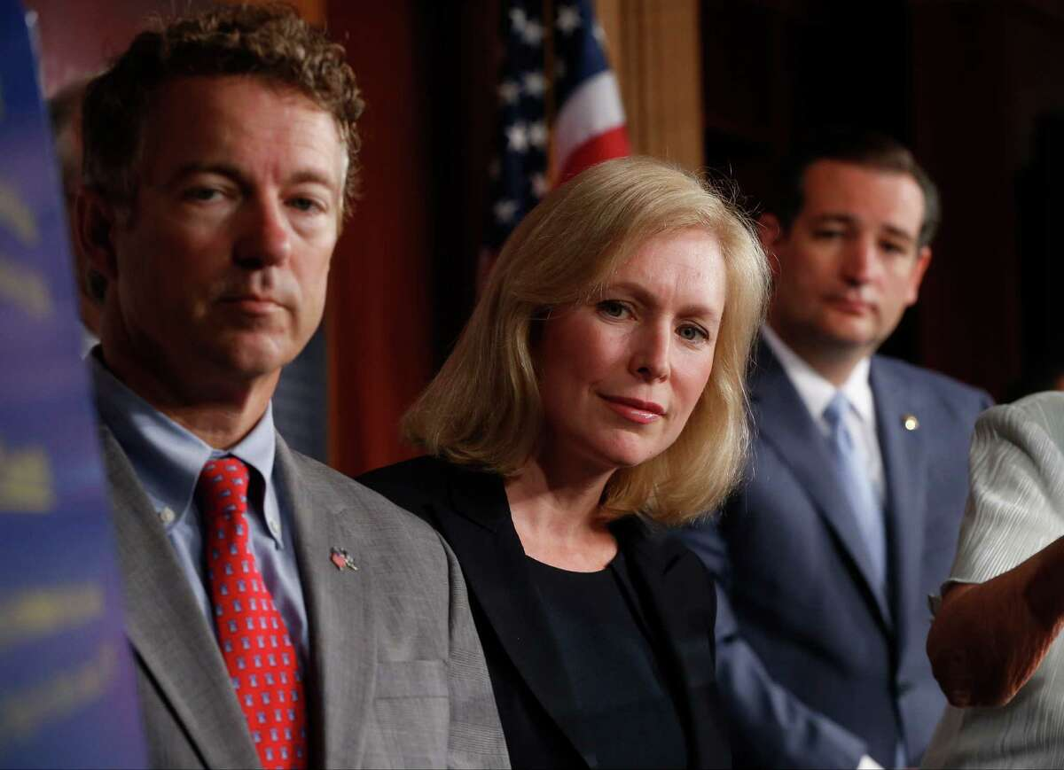 Sen. Kirsten Gillibrand, D-N.Y., Sen. Rand Paul, R-Ky., and Sen. Ted Cruz, R-Texas speak to reporters during a news conference about a bill regarding military sexual assault cases on Capitol Hill in Washington, July 16, 2013.
