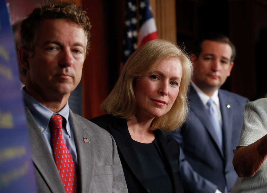 Sen. Kirsten Gillibrand, D-N.Y., Sen. Rand Paul, R-Ky., and Sen. Ted Cruz, R-Texas speak to reporters during a news conference about a bill regarding military sexual assault cases on Capitol Hill in Washington, July 16, 2013.  Photo: Charles Dharapak, Associated Press / AP