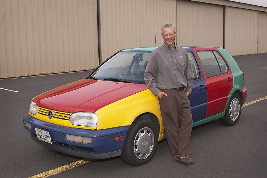 Photos of Glenn Reynolds and his 1996 Volkswagon Golf, 'Harlequin' special model and paint, green body, at the Half Moon Bay/San Mateo County Airport on April 2, 2013.