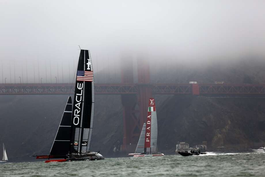 The Oracle Team USA and Luna Rossa sail in front of the Golden Gate Bridge before a race between the Emirates Team New Zealand and Artemis for a round robin of the Louis Vuitton Cup in San Francisco, Calif. on July 18, 2013.