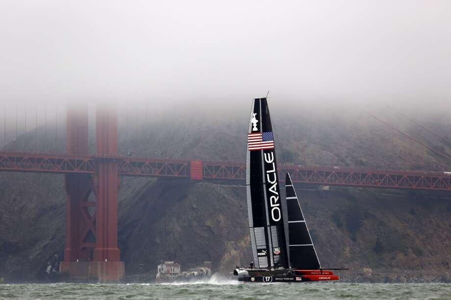The Oracle Team USA sails in front of the Golden Gate Bridge before a race between the Emirates Team New Zealand and Artemis for a round robin of the Louis Vuitton Cup in San Francisco, Calif. on July 18, 2013.