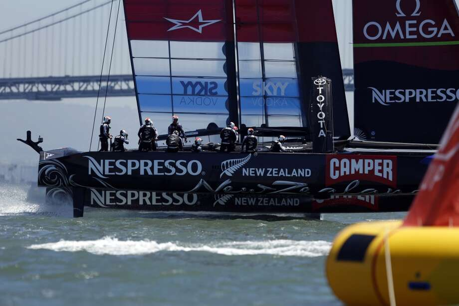 The Emirates Team New Zealand crosses the finish line during a solo race against Artemis for the Louis Vuitton Cup in San Francisco, Calif. on July 18, 2013.