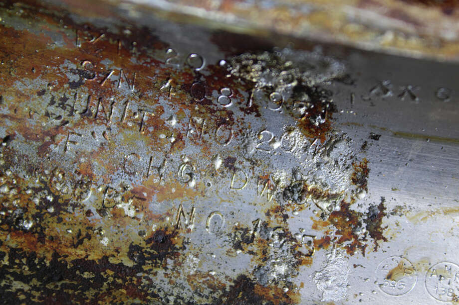 A detail of a recovered F-1 rocket engine, showing the serial number confirming that it came from the Apollo 11 rocket. Photo: Bezos Expeditions