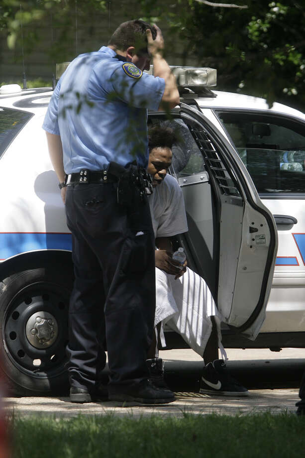 A man sits in the back of a police car as police investigate the scene where a group of people were held against their will. Police are investigating a report that four people were being held against their will at a home in north Houston Friday morning. The incident occurred about 8:30 a.m. at 8646 White Castle near Old Ledge, according to the Houston Police Department. Police said officers were dispatched to the scene on a welfare check after a someone called 911 and said four people were being held at the home against their will. Details are sketchy. It's unclear how long the people had been at the home or if any suspects were in custody. Officers are trying to piece together what happened.  Cody Duty/ Chronicle Photo: Cody Duty / Chronicle