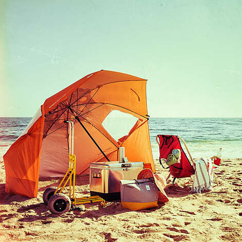 """Soaking it all up SoCal beach regulars pick the best gear for a place in the sun. Pop-up shade. """"This tent-umbrella combo gives you a big spot to duck under; it's perfect for families."""" —Kyle Daniels, L.A. County lifeguard captain. Sport-Brella: $60; sportbrella.com Haul-it-all cart. """"A cart or wagon with huge tires helps you get through the sand. The guys who really know what they are doing can get a boogie board and a cooler on one."""" —David LeFevre, chef-owner, Manhattan Beach Post. Beach Cart Folding—Mini: $140; wheeleez.com Portable speaker. """"A lightweight music player is key. It should be loud enough that you can hear it, but not louder than the waves."""" —Lizzie Garrett Mettler, culture blogger, Tomboy Style. UE Boom wireless speaker: $200; ultimateears.com Duffel bag. """"I can fit everything I need—towel, sunscreen, books—into this roomy tote. Plus, the pop of color pretty much screams summer."""" —Joy Cho, design blogger, Oh Joy. Albright duffel: $90; www.fleetobjects.com Backpack chair. """"Once you have one of these, you wonder how you ever lugged other beach chairs around."""" —David LeFevre. Wearever Backpack Chair: $30; shadeusa.com  Photo: Thomas J. Story, Sunset.com / © Thomas J. Story/Sunset Publishing"""
