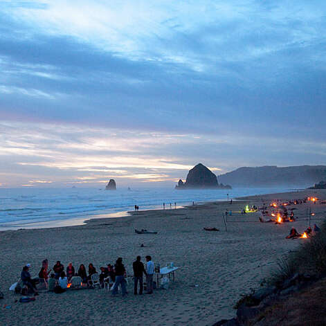 The bonfire Stick around after sunset—here's where to light a fire on the sand. Most artistic firepits. Eight fanciful fire rings dot the quarter-mile of San Francisco's Ocean Beach where bonfires are still legal. First come, first served; nps.gov/goga  Best views of tall rocks. Build your pit on northern Oregon's Cannon Beach (pictured) and your backdrop is Haystack Rock, a 235-foot basalt sea stack. cannonbeach.org  200+ fire rings to choose from. Chances are good you'll score a fireside spot at Bolsa Chica State Beach, halfway between L.A. and San Diego. Bonus: Numbered lifeguard stations make for good GPS, so friends can locate you. First come, first served; parks.ca.gov More: Top 20 beach hotels   Photo: Kevin J. MiyazakI, Sunset.com / © Kevin J. Miyazaki, 2009  All rights reserved.
