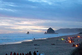 The bonfire Stick around after sunset-here's where to light a fire on the sand. Most artistic firepits. Eight fanciful fire rings dot the quarter-mile of San Francisco's Ocean Beach where bonfires are still legal. First come, first served; nps.gov/goga Best views of tall rocks. Build your pit on northern Oregon's Cannon Beach (pictured) and your backdrop is Haystack Rock, a 235-foot basalt sea stack. cannonbeach.org 200+ fire rings to choose from. Chances are good you'll score a fireside spot at Bolsa Chica State Beach, halfway between L.A. and San Diego. Bonus: Numbered lifeguard stations make for good GPS, so friends can locate you. First come, first served; parks.ca.gov