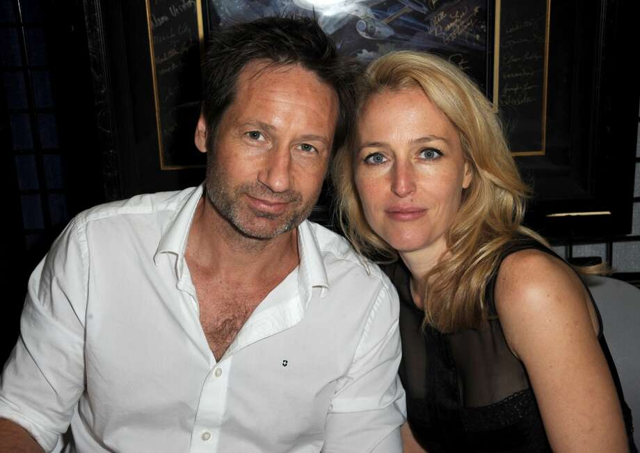 Actors David Duchovny (L) and Gillian Anderson pose during Comic-Con International at San Diego Convention Center on July 18, 2013 in San Diego, California.  (Photo by Albert L. Ortega/Getty Images)