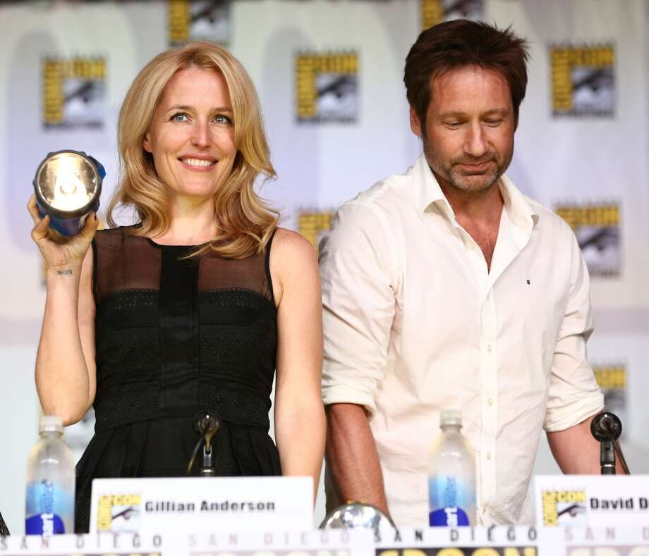 Actress Gillian Anderson (L) and actor David Duchovny attend the 20th Anniversary celebration of the X-Files with TV Guide Magazine during Comic-Con International 2013 at San Diego Convention Center on July 18, 2013 in San Diego, California.  (Photo by Imeh Akpanudosen/Getty Images)