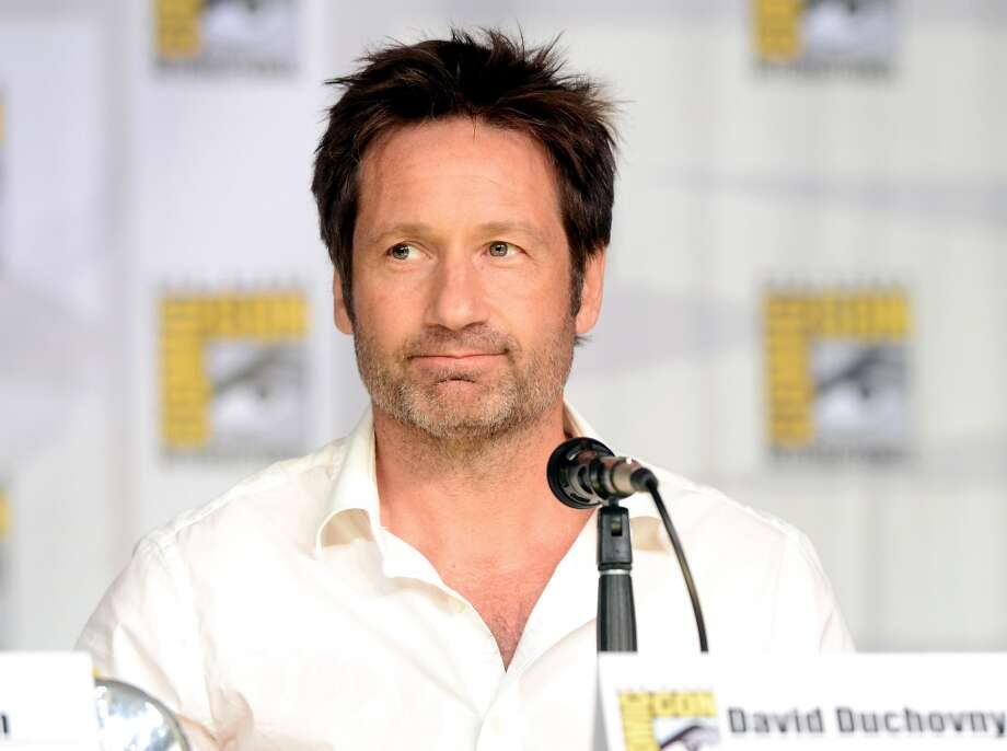 Actor David Duchovny speaks onstage during the 20th Anniversary celebration of the X-Files with TV Guide during Comic-Con International 2013 at San Diego Convention Center on July 18, 2013 in San Diego, California.  (Photo by Albert L. Ortega/Getty Images)
