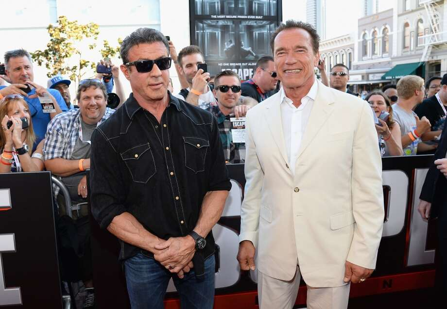 "Actor Sylvester Stallone and Actor/Former California Gov. Arnold Schwarzenegger arrive at the ""Escape Plan"" premiere during Comic-Con International 2013 at the Reading Cinemas Gaslamp on July 18, 2013 in San Diego, California.  (Photo by Ethan Miller/Getty Images)"