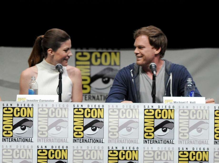 "Actors Jennifer Carpenter (L) and Michael C. Hall speak onstage at Showtime's ""Dexter"" panel during Comic-Con International 2013 at San Diego Convention Center on July 18, 2013 in San Diego, California.  (Photo by Kevin Winter/Getty Images)"