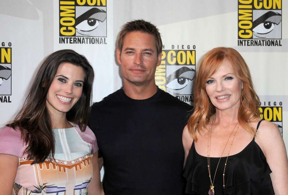 "(L-R) Actors Meghan Ory, Josh Holloway and Marg Helgenberger speak onstage at the ""Intelligence"" panel during Comic-Con International 2013 at San Diego Convention Center on July 18, 2013 in San Diego, California.  (Photo by Albert L. Ortega/Getty Images)"