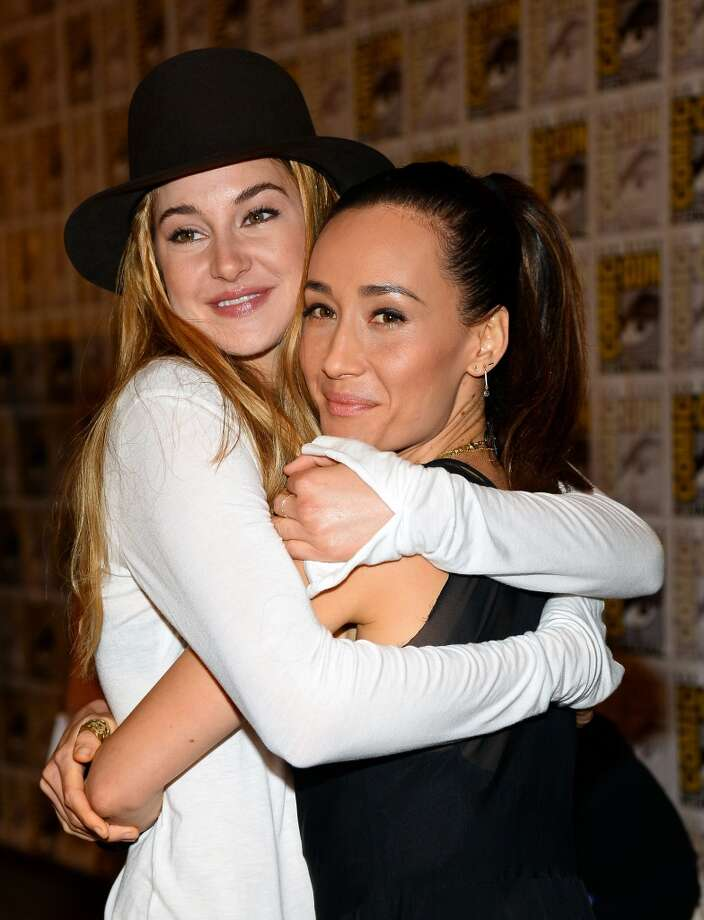 """Actresses Shailene Woodley (L) and Maggie Q attend """"Ender's Game"""" and """"Divergent"""" Press Line during Comic-Con International 2013 at Hilton San Diego Bayfront Hotel on July 18, 2013 in San Diego, California.  (Photo by Ethan Miller/Getty Images)"""