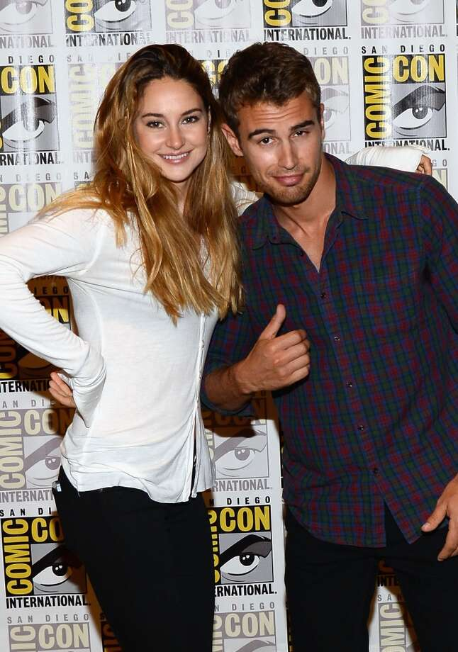 "Actress Shailene Woodley (L) and actor Theo James attend ""Enders Game"" and ""Divergent"" Press Line during Comic-Con International 2013 at Hilton San Diego Bayfront Hotel on July 18, 2013 in San Diego, California.  (Photo by Ethan Miller/Getty Images)"