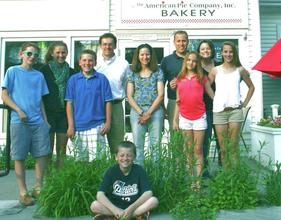 The American Pie Company, Inc.  in Sherman is very much a family business. Among those who lend their efforts to serving their patrons are, in front, Tommy Day, and, from left to right, Jack Day, Emily Day, James Day, Dave Day, owner Audrey Day, business partner Bill Hunniford, Abby Hunniford, Alicia Hunniford and Emma Hunniford.  Courtesy of American Pie Company Bakery Photo: Contributed Photo
