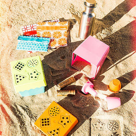 """Zero-plastic beach day Anna Cummins, environmentalist and cofounder of L.A.'s The 5 Gyres Institute, gives her green gear picks. Sunscreen. """"I just found a plastic-free sunscreen! It's packaged in a cardboard tube—and is organic too."""" Surfer's Barrier Stick (SPF 30): $15; avasol.com Sandwich bags. """"I encourage people to ditch the Ziploc and go with reusable cotton bags."""" LunchSkins: 3 sizes; from $7.85 each; lunchskins.com Toys. """"I love these marine-degradable bioplastic ones—if they accidentally get washed out to sea, they'll break down in two to three years."""" Beach toys: 2 color combos; $22/5-piece set; zoeborganic.com Bottle. """"Bring drinks in reusable stainless steel bottles."""" Reflect Kanteen (with bamboo lid), $33/27 oz.; kleankanteen.com   Photo: Thomas J. Story, Sunset.com / © Thomas J. Story/Sunset Publishing"""