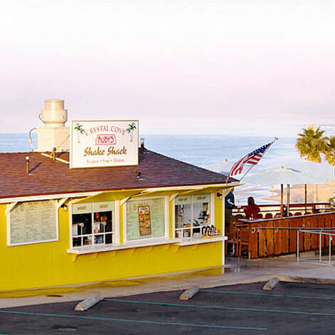 Indulging in an icy treat For generations it was the Date Shack. Then it became Crystal Cove Ruby's Shake Shack. But the Newport Coast institution Ruby's Shake Shack is as good as ever, with 20-plus shakes and malts. 7703 E. Coast Hwy.; rubys.com More: Top 14 unsung beach towns   Photo: Thomas J. Story, Sunset.com / no credit