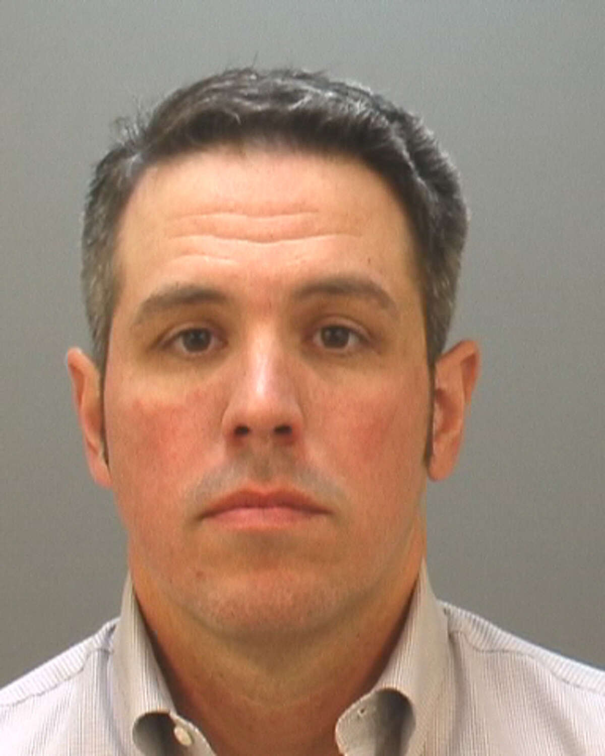 San Marcos police officer James Palermo who was arrested on charges of aggravated assault with serious bodily injury by a public servant, is seen in an undated booking mug provided Friday July 19, 2013 by the Hays County District Attorney's Office