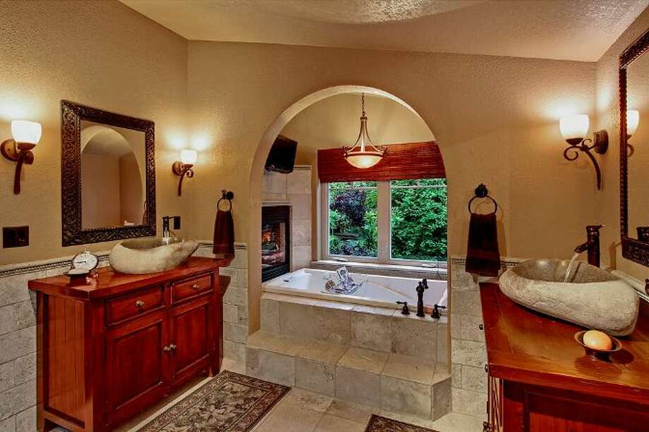 Bathroom of 3307 S.W. Andover St. It's listed for $1.199 million. Photo: Courtesy Adam E. Cobb, Windermere Real Estate