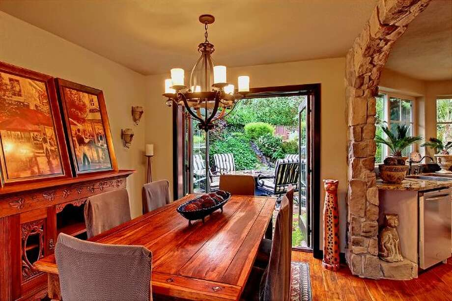 Dining room of 3307 S.W. Andover St. It's listed for $1.199 million. Photo: Courtesy Adam E. Cobb, Windermere Real Estate