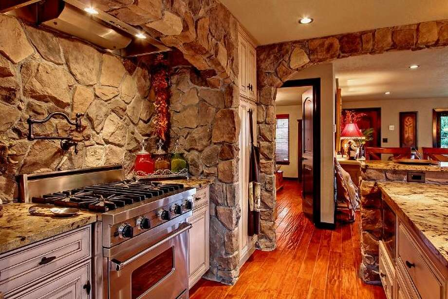 Kitchen of 3307 S.W. Andover St. It's listed for $1.199 million. Photo: Courtesy Adam E. Cobb, Windermere Real Estate