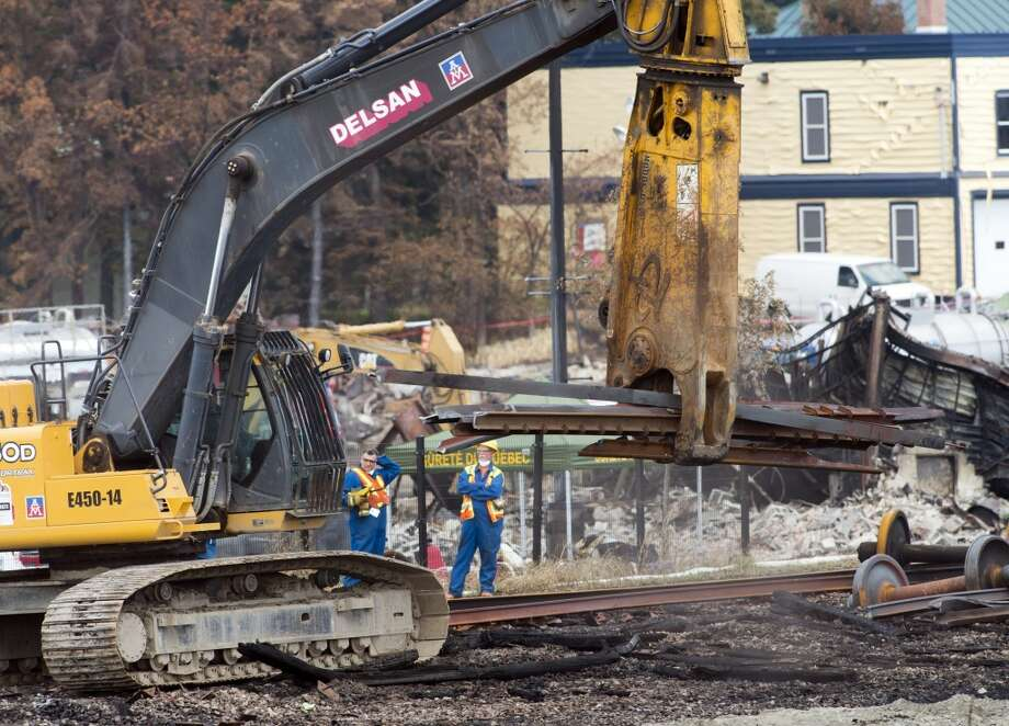 Work continues Tuesday, July 16, 2013, at the crash site of the train derailment and fire in Lac-Megantic, Quebec.  The July 6, 2013, accident   left 37 people confirmed dead and another 13 missing and presumed dead.  (AP Photo/Ryan Remiorz, pool) Photo: Ryan Remiorz, Associated Press