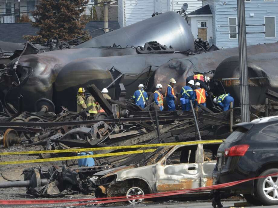 Emergency workers examine the  aftermath of a train derailment and fire in Lac-Megantic, Quebec, on Tuesday, July 16, 2013. Thirty-seven bodies have been recovered and another 13 people missing are still missinfg after the July 6, 2013, derailment. (AP Photo/Ryan Remiorz, Pool) Photo: Ryan Remiorz, Associated Press