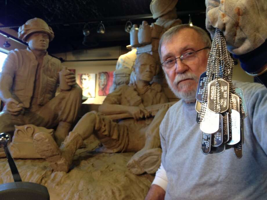 Don Dorsey, who served in the U.S. Marines during Vietnam, hand embossed the Texas Vietnam Heroes dog tags.  In the background is the Texas Capitol Vietnam Veterans Monument in progress.