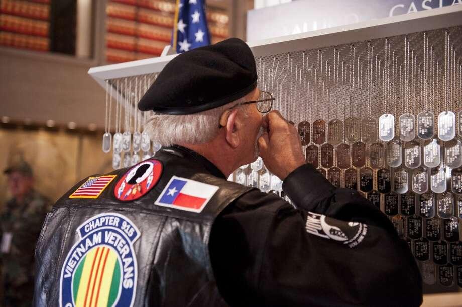 Vietnam veteran Roy McCrary of Austin visits the Texas Vietnam Heroes Exhibit at the LBJ Presidential Library in Austin.