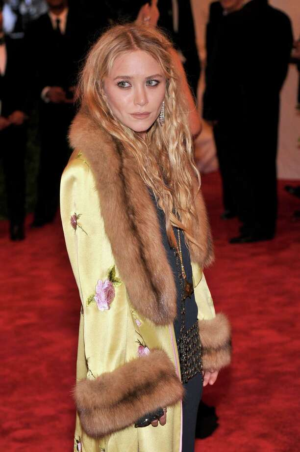 """Mary-Kate Olsen entered treatment for anorexia in 2004. She was known to be a close friend to late actor Heath Ledger and is now dating former French President Nicholas Sarkozy's half-brother, Olivier Sarkozy.She is noted in fashion circles for her """"homeless"""" look. Photo: Stephen Lovekin, Getty / 2013 FilmMagic"""