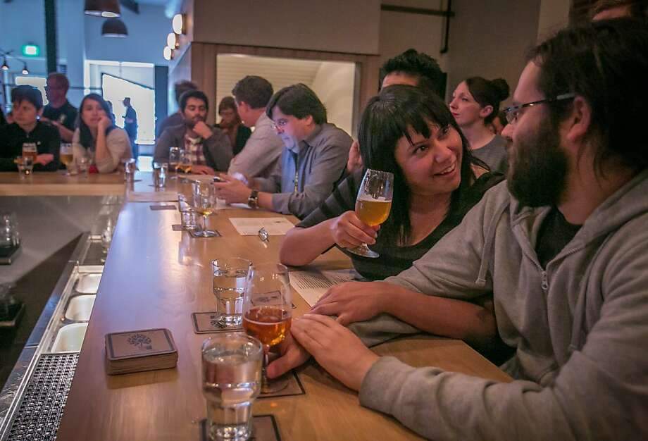 More than 40 beers are on tap at Mikkeller which offers beer-friendly foods such as a house-made half smoked sausage on its menu. Photo: John Storey, Special To The Chronicle
