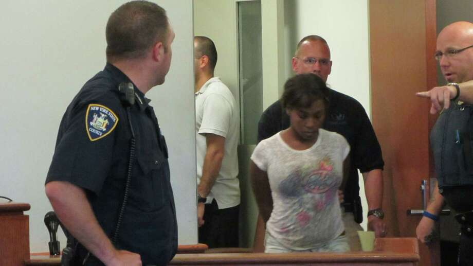 Audrea Gause, 26, of 245 Ninth St., Troy, is led into Troy City Court on Friday, July 19, 2013,  to face charges for being a fugitive from justice. Authorities in Massachusetts say Gause faked medical records to be paid $480,000 from the One Fund Boston, the charity set up for victims of the Boston Marathon bombing. (Bob Gardininer / Times Union archive)